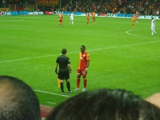 Drogba discusses the metaphysics of ontology with the referee's official. Possibly.